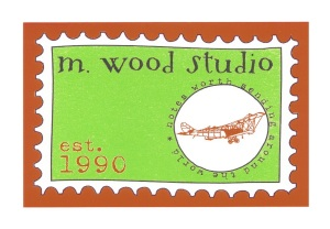 m wood studio stamp orange logo